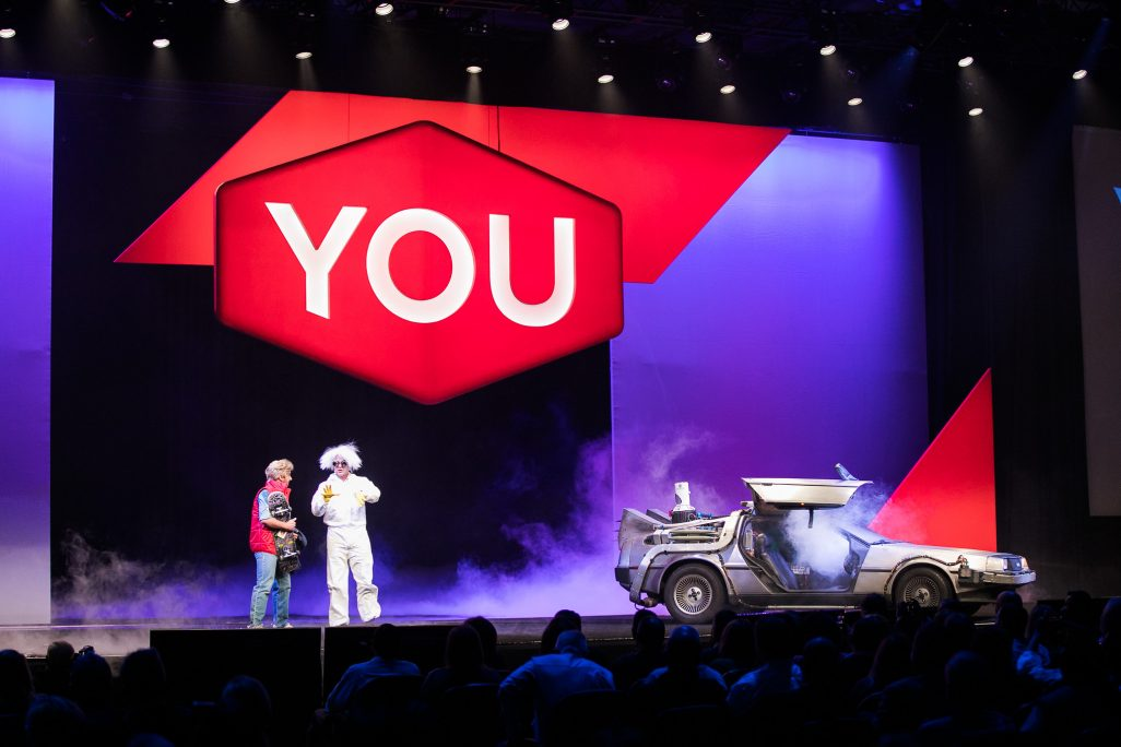 two people with car on stage